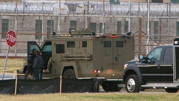 Officers respond to a siege at Vaughn prison near Smyrna
