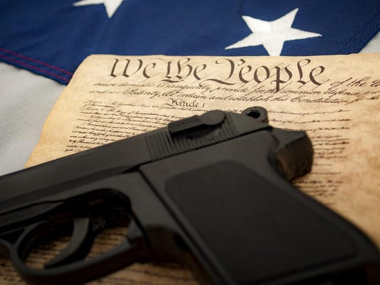 American Flag, a handgun and the US constitution