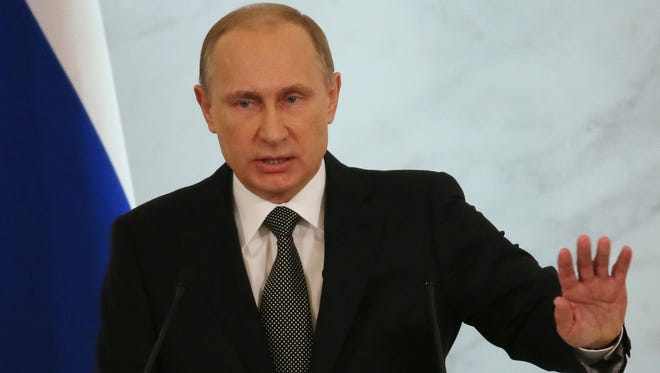 Russian President Vladimir Putin addresses the Federal Assembly in the Kremlin in Moscow, on Dec.4.