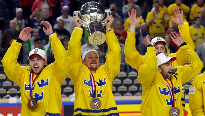 Sweden players celebrate following the IIHF World Championships final.