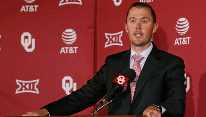 Lincoln Riley speaks at a news conference where he was announced as Oklahoma's football coach in Norman, Okla.