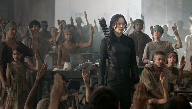 "Jennifer Lawrence stars as Katniss Everdeen  in the third installment of  ""The Hunger Games: Mockingjay — Part 1."""
