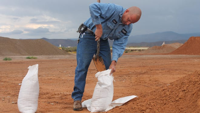 Inventory Specialist for the Otero County Alamogordo Road Shop Patrick Lucero fills up sand bags ready to take home for residents in the community.