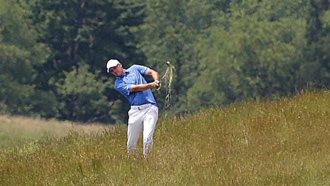 Jordan Spieth  hacks his ball out of the tall fescue and lands within 4 feet of the cup on the eighth hole during a practice round Monday for the U.S. Open at Erin Hills.