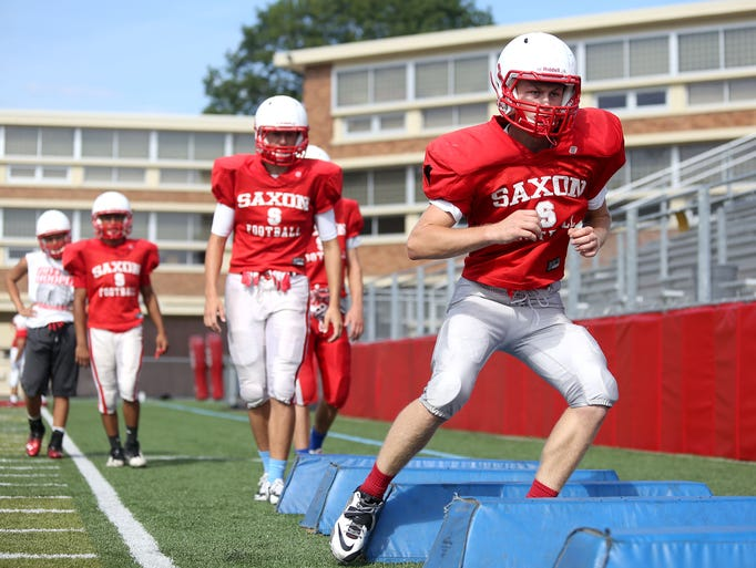 Members of the South Salem High School football team practice on Thursday, Aug. 21, 2014, in Salem, Ore.