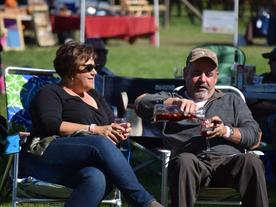 Karen Gasior of Marlton and Mike Minniti of Winslow relax during the Italian Festival at Bellview Winery on Oct. 15.