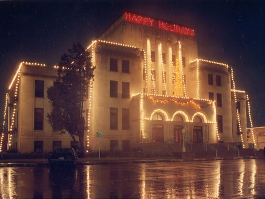 San Angelo City Hall's Christmas lights are reflected in water from a recent rainfall. Date unknown.