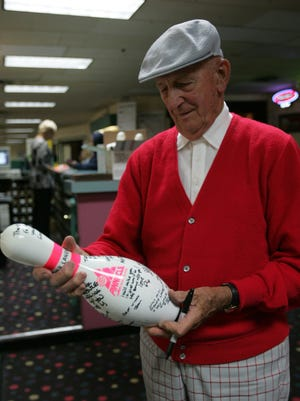 At the closing of Dover Lanes in 2008,     John J. Klusick  Jr. signs a commemorative bowling pin. Klusick  died Monday  at age 94.