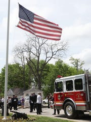 City of Poughkeepsie Fire Engine 2 parked in front of McHoul Funeral Home during the wake of fallen firefighter Timothy Gunther in Hopewell Junction on Saturday.
