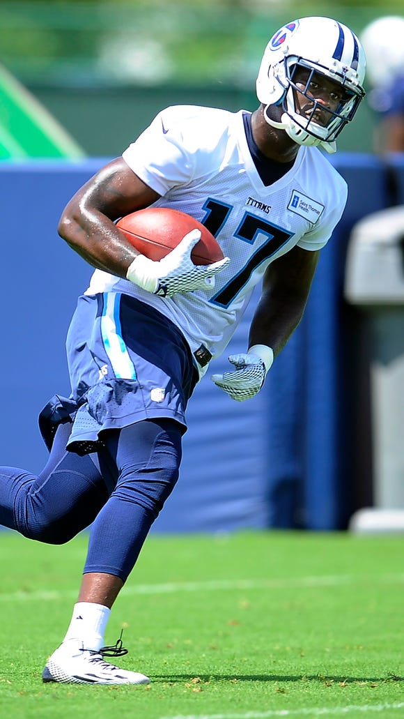 Titans wide receiver Dorial Green-Beckham (17) races up the field with a catch during practice at Saint Thomas Sports Park on Tuesday in Nashville.
