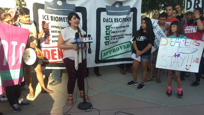 Reyna Montoya, a DACA recipient, speaks outside of ICE offices in Phoenix during a demonstration in support of DACA on Aug. 31, 2017.
