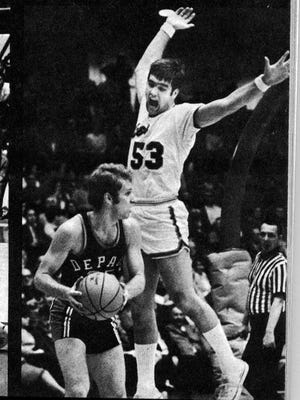 Former UE standout John Wellemeyer (with arms upraised) was inducted into the Indiana Basketball HOF