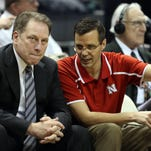 Michigan State Spartans basketball coach Tom Izzo and Nebraska Cornhuskers coach Tim Miles talk prior to a game.