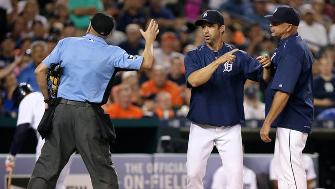 Tigers manager Brad Ausmus, center, is tossed by home plate umpire Mike Everitt, left, who had already ejected hitting coach Wally Joyner, right, during the fifth inning Saturday at Comerica Park.