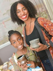 Kaitlyn and Naeemah Gary display their handcrafted