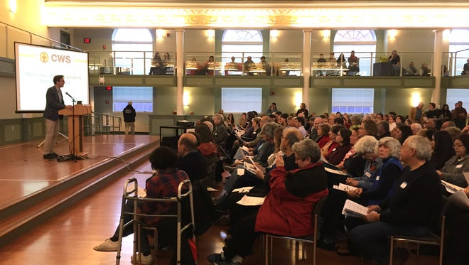 An informational meeting on the recently announced plan to open a City of Poughkeepsie-based refugee resettlement office drew a standing-room-only crowd at Vassar College on Sunday.
