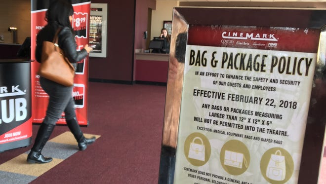 Century Theatres parent company Cinemark is banning large bags from its premises, citing safety concerns.