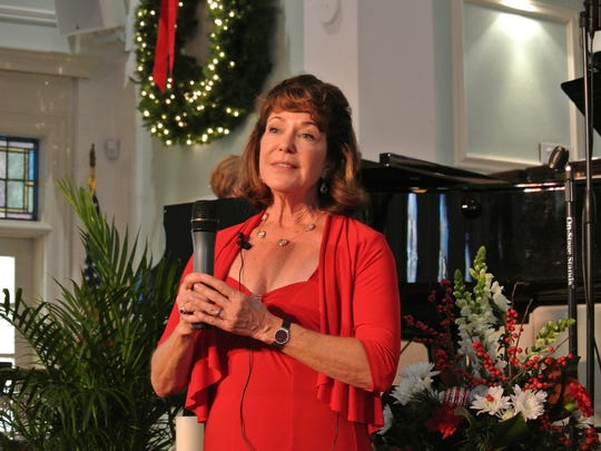 Beth Filowich sings 'O Holy Night' at last year's Christmas Carol Sing at First Presbyterian Church in Fort Myers.
