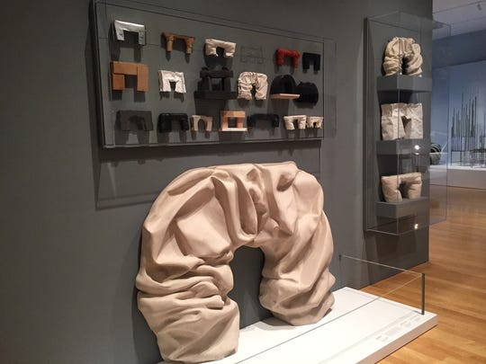Faye Toodgood experiments with unexpected materials, like this folded fireplace sculpted from stone.