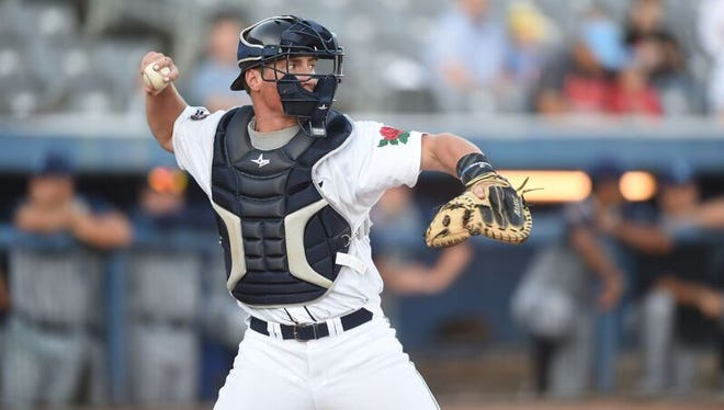 Rocori graduate and Connecticut Tigers catcher Austin Athmann throws to second base during a game this season. Athmann is in his first season with the Class A short-season affiliate of the Detroit Tigers.