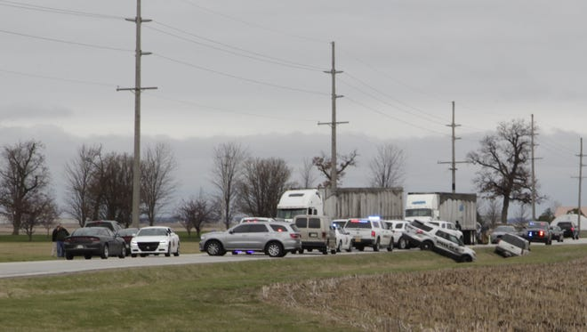 Dozens of police cruisers and semis crowd the scene where a pursuit ended in a police-action shooting Tuesday, March 28, 2017, on U.S. 421 near the White County and Pulaski County Line.