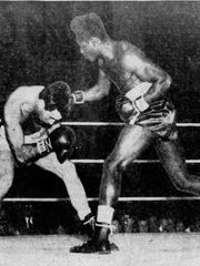 Ezzard Charles, right, scored a split decision against