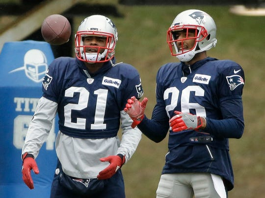 New England Patriots cornerbacks Malcolm Butler, left, and Logan Ryan will be tasked with slowing down Matt Ryan in Sunday's Super Bowl.