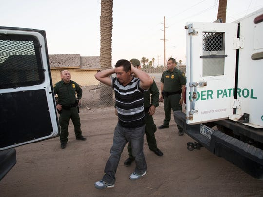 Customs and Border Protection agents prepare move Efrain Rocha from one vehicle to another after he was detained as he entered the U.S. without proper documentation the U.S. at the Calexico/Mexicali international border wall on June 19, 2018.