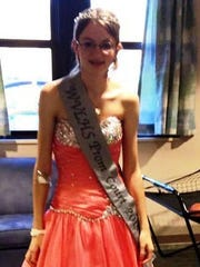 The students of WI Valley voted Alex Dickinson, Wausau, their 2015 Junior Prom Queen. Dickenson, pictured in her dress and sash, was unable to attend the prom because she was in the hospital awaiting surgery.