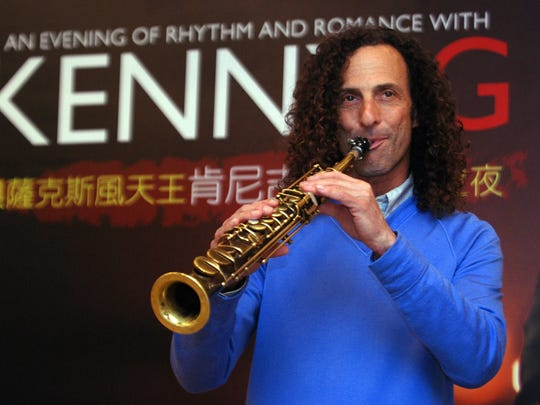 FILE - In this May 14, 2010 file photo, Kenny G, smooth jazz saxophonist, performs during a media event announcing his concert, in Taipei, Taiwan. Kenny G stopped in at Hong Kong's pro-democracy protests on Wednesday, Oct. 22, 2014, but his visit was out of tune with Chinese authorities, who have warned about meddling by foreign forces. (AP Photo/Chiang Ying-ying, File)