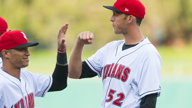 Indianapolis Indians pitcher John Holdzkom (52) greets his teammates during team introductions. The Indianapolis Indians hosted the Columbus Clippers for their home opener in MiLB action at Victory Field Thursday, April 9, 2015.