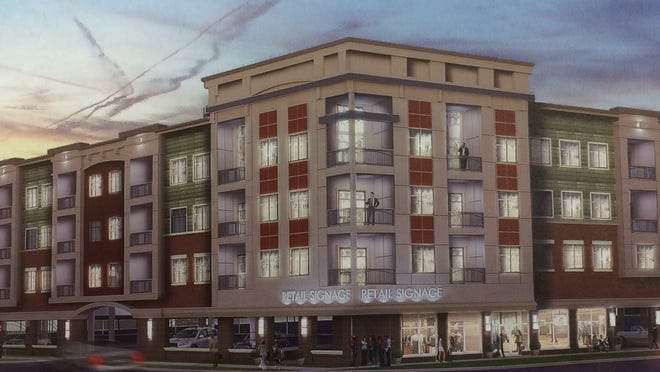 An artist's rendering of a proposed four-story building with retail and apartments near the corner of East Grand River and Spartan avenues in East Lansing. This project would tear down the vacant Citgo gas station and former Tasty Twist and Tasty Treat ice cream shop buildings on Grand River.