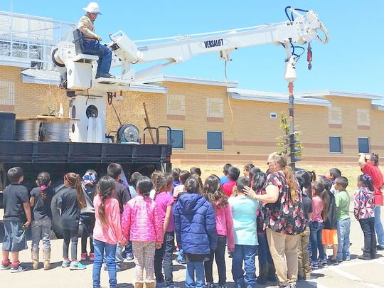 "Sam Sanchez takes ""the digger"" up for students."
