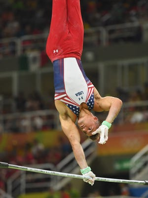 Samuel Mikulak competes on the horizontal bar .