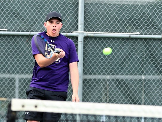 Sterling City's Dain Copeland returns a serve during