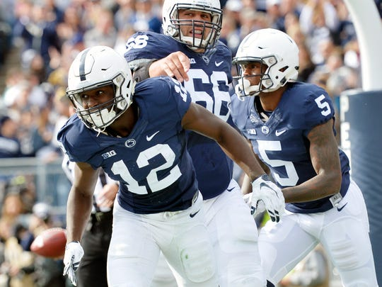 Penn State Nittany Lions wide receiver Chris Godwin (12) leaves the end zone after his touchdown in the first half of an NCAA Division I football game Saturday, Oct. 31, 2015, at Beaver Stadium. Penn State swept Illinois 39-0.