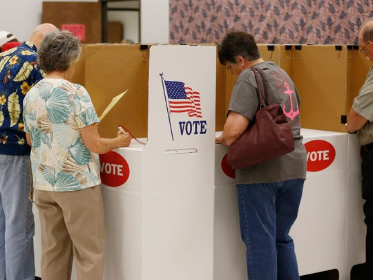 Thirty-three states allow early voting. In this file photo from June 2014, voters participate in early voting in Oklahoma City, Oklahoma. Democratic state senators want to expand early voting in New Jersey. (AP Photo/Sue Ogrocki)