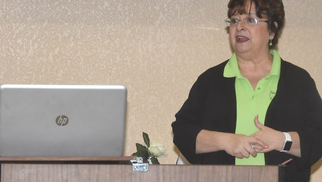 Ginger Lecompte, St. Landry-Evangeline United Way director, addresses the audience at Thursday's ALICE economic conference held in Opelousas.