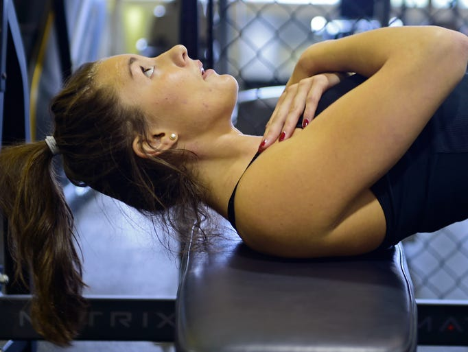 Hannah Durbin, a senior at Elon University, works out