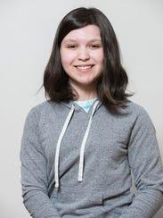 Emily Harris portrays Caitlin, an artistic girl with