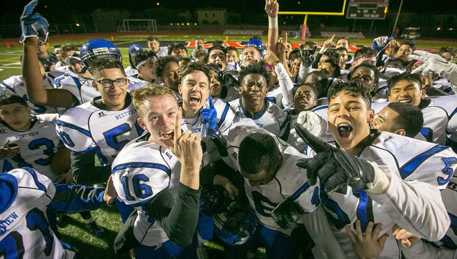 Avondale Westview players celebrate their high school football playoffs game win against Gilbert Williams Field in Gilbert on Friday, November 13, 2015. #HSfb