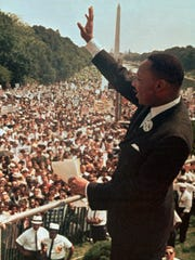 "The Rev. Martin Luther King Jr. waves to the crowd on the National Mall in Washington, D.C., on Aug. 28, 1963, when he delivered his famous ""I Have a Dream'' speech."
