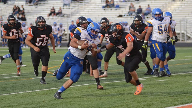 Taos' Rec Reid attempts to tackle Bloomfield's JD Robinson during a game on Sept. 18 in Taos.
