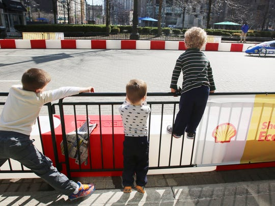 Gino Gisevan, 6, of St. Clair Shores, left, Dominic Mazzocco, 2, center, of Clawson and Julian Gisevan, 3, of St. Clair Shores are excited as they watch cars zoom by in downtown Detroit during  the Shell Eco-Marathon Americas competition on April 12.