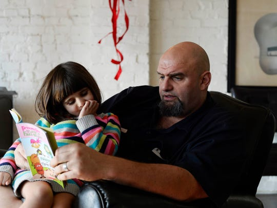 John Fetterman reads to his daughter, 4-year-old Grace Fetterman, at their home in Braddock, Pa., Tuesday, December 22, 2015. Fetterman, who grew up in Springettsbury Township, has been mayor of Braddock since 2005, and is now running for U.S. Senate.
