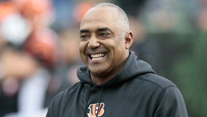 Bengals head coach Marvin Lewis smiles as he throws passes during warmups before their win over the Rams.