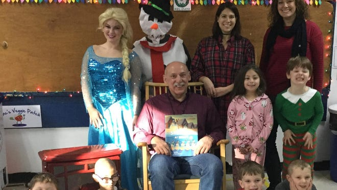 At the Hudson Maxim School, pictured from left to right, are Alexandra Daniel (Lexie) Queen Elsa, Pajama Program Coordinators - Suzanne Annette (Snowwoman), Jamie Gambuzza and Lisa Schuffenhauer. Storyteller - Jerry Andrewlavage and students from left to right: Lee Reichenthal, Jack Houston, standing: Sophia Stone, Eli Mauldin, sitting: Joseph Seck and Gregory Don.