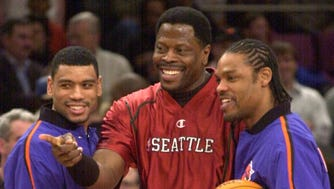 Seattle Sonics' Patrick Ewing, center, chatting with his former teammates Allan Houston, left, and Latrell Sprewell before their game in 2001 at Madison Square Garden. It was Ewing's first visit to the Garden since his trade to Seattle.
