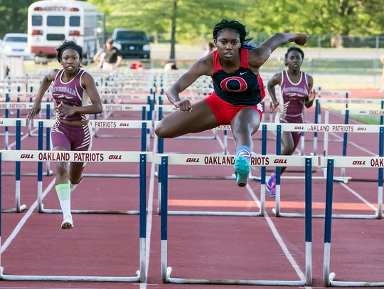 Oakland High School's Imani Udoumana easily wins the