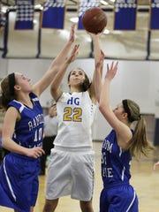 Howards Grove's Samantha Yancy (22) makes a shot against